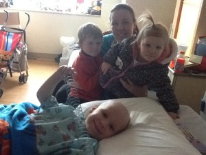 zachary with anne and the other kids after his surgery